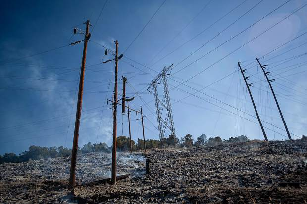 A powerline dangles and burns in the Lake Christine fire in Basalt, Colorado on July 4, 2018.