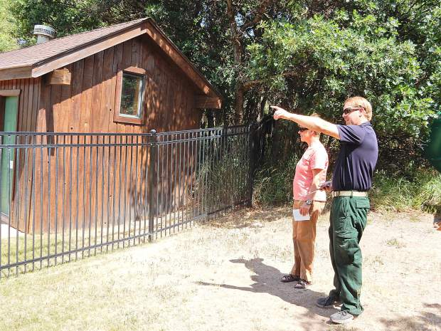 Eagle County Wildfire Mitigation Coordinator Eric Lovgren (right) points out work that needs to be done at the Aspen Mountain View subdivision community center to homeowners' association president Nancy Bobrow.