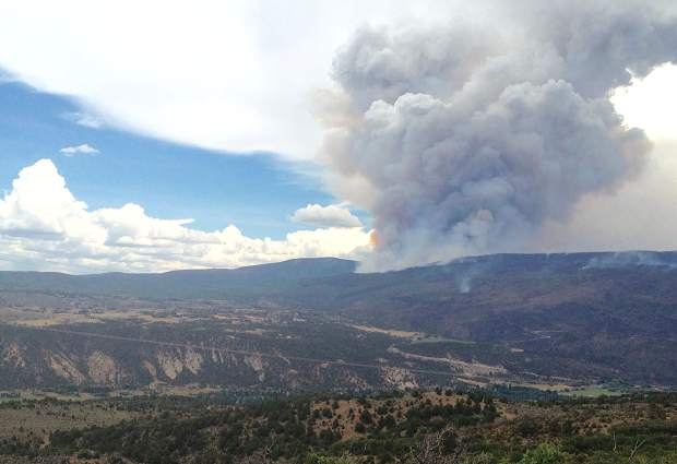This picture of the Lake Christine Fire was taken from atop the Crown on Saturday. The Missouri Heights area to the left is generally considered in a moderate to high hazard zone for wildfires.