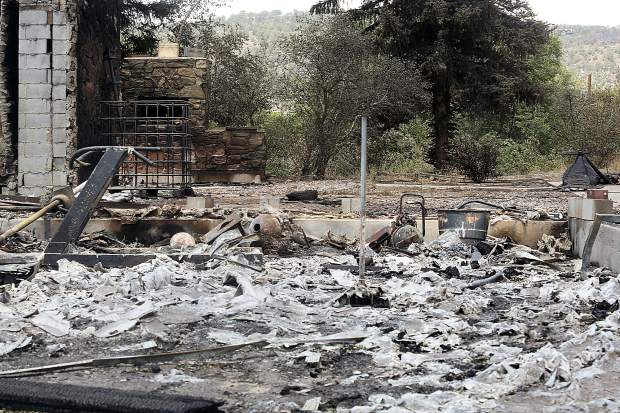 A home sits in ruin on Lava Dr. Sunday, July 8, 2018, in El Jebel after being destroyed by the Lake Christine Fire. (Photo by Austin Colbert/The Aspen Times).