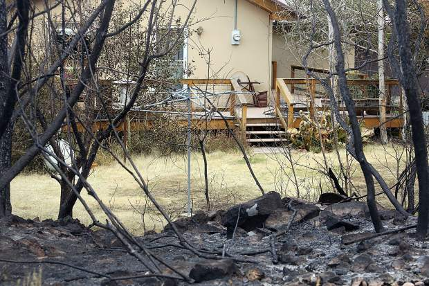 The fire line from the Lake Christine Fire enroached on a home in El Jebel. (Photo by Austin Colbert/The Aspen Times).