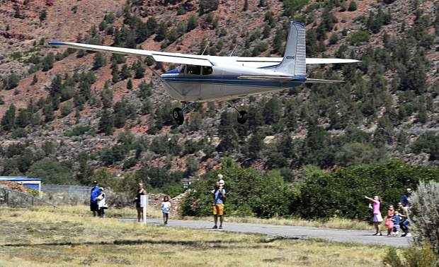 Visitors to the Glenwood Springs Airport get an up close look at a plane as it comes in for a landing during Saturday's Aviation Expo.