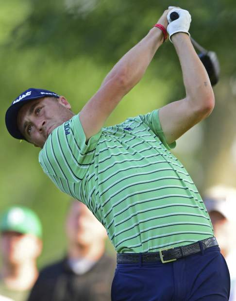 Justin Thomas watches his tee shot on the 18th hole during the final round of the Bridgestone Invitational golf tournament at Firestone Country Club, Sunday, Aug. 5, 2018, in Akron, Ohio. (AP Photo/David Dermer)