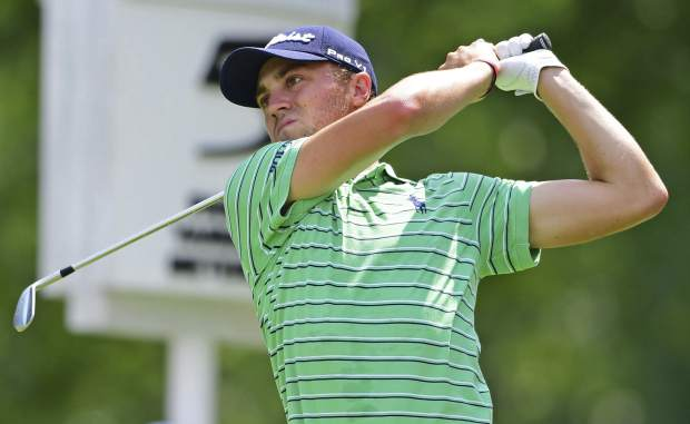 Justin Thomas watches his tee shot on the fifth hole during the final round of the Bridgestone Invitational golf tournament at Firestone Country Club, Sunday, Aug. 5, 2018, in Akron, Ohio. (AP Photo/David Dermer)