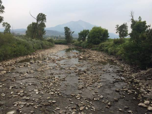 The lower Crystal River was running at 8 cfs near the state fish hatchery on Friday. Lows flows on the Crystal have spurred action from the state, including curtailment and a call for instream flows.