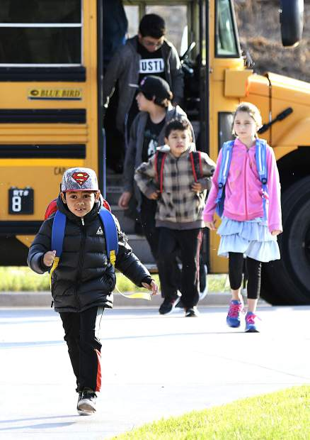 A school bus drops students off at Riverview School Monday in Glenwood Springs.