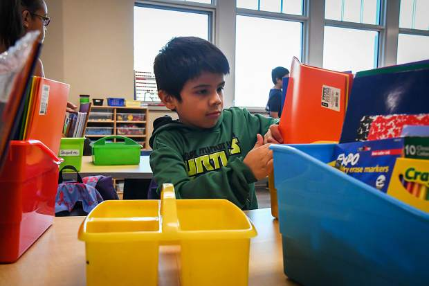 Nathan Fuentes organizes his school supplies during his first day as a second-grader at Glenwood Springs Elementary School on Monday morning.
