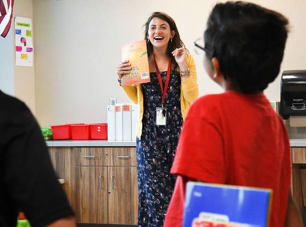 Glenwood Springs Elementary School teacher Hallie Zurawel welcomes her new second graders during the first day of classes on Monday morning.