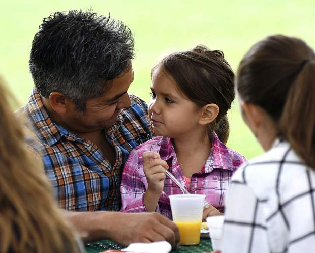 Gil Villarreal and his daughter Emma, 5, of Silt enjoy pancakes together Saturday during the annual Silt HeyDays Pancake Breakfast at Stoney Ridge Park.