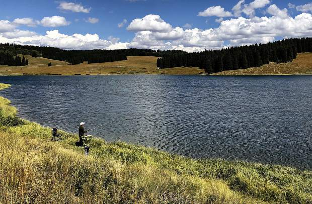 A father and son enjoy a sunny afternoon of fishing at Meadow Creek Lake north of New Castle in the White RIver National Forest. Forecasts for the week are calling for high temperatures in the low to mid 80s.