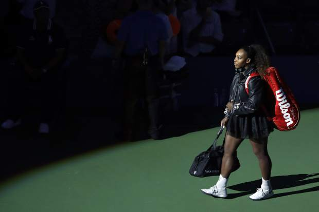 Serena Williams, of the United States, walks onto the court before her match against Magda Linette, of Poland, during the first round of the U.S. Open tennis tournament, Monday, Aug. 27, 2018, in New York. (AP Photo/Jason DeCrow)
