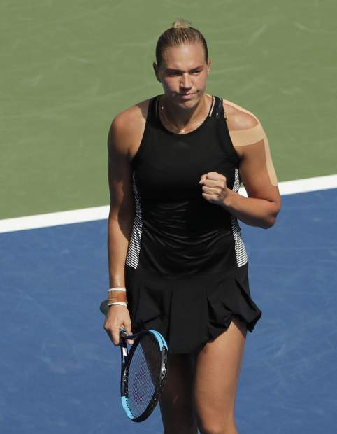 Kaia Kanepi, of Estonia, reacts during her match against Simona Halep, of Romania, during the first round of the U.S. Open tennis tournament, Monday, Aug. 27, 2018, in New York. (AP Photo/Andres Kudacki)