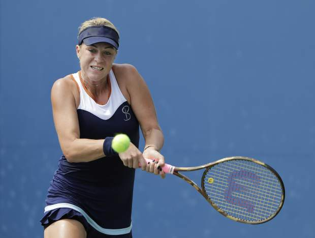 Anastasia Pavlyuchenkova, of Russia, returns a shot to Rebecca Peterson, of Sweden, during the first round of the U.S. Open tennis tournament, Monday, Aug. 27, 2018, in New York. (AP Photo/Jason DeCrow)
