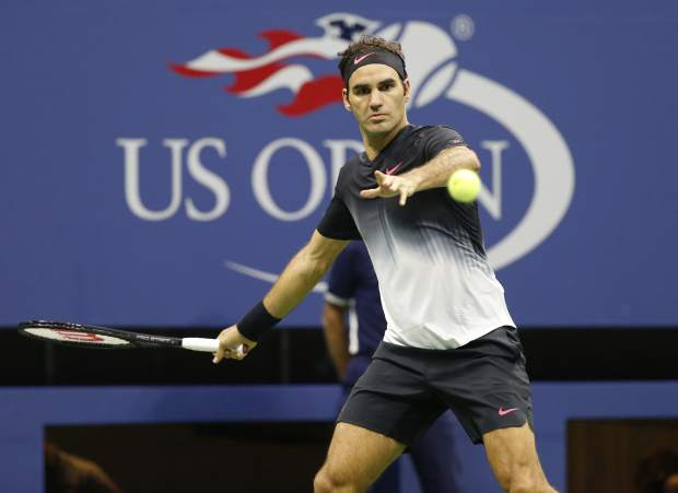 FILE - In this Sept. 4, 2017, file photo, Roger Federer, of Switzerland, makes a return against Philipp Kohlschreiber, of Germany, in a fourth-round match at the U.S. Open tennis tournament in New York. When Federer won five straight U.S. Opens, he used to arrive in New York knowing he had all the answers. It's been 10 years since the last one, but at 37 Federer believes he'll be sharp enough to navigate a difficult draw and compete for another championship when main-draw play at the year's final Grand Slam tournament begins Monday. (AP Photo/Kathy Willens, File)