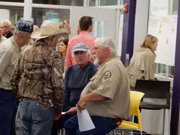 Perry Will, area wildlife manager for Colorado Parks and Wildlife, chats with people who attended a public meeting Monday on the Basalt shooting range.