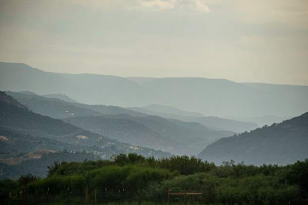 Wildfire smoke lingers in the Basalt valley on Thursday morning.