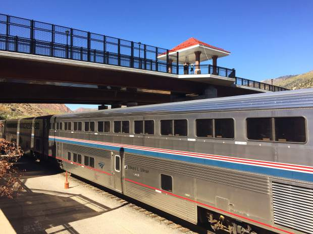 A pair of onlookers watch from the downtown pedestrian bridge as the eastbound Amtrak California Zephyr, including the Edward L. Ullman sleeper car, rolls into the Glenwood Springs train station Tuesday afternoon. Ullman (1912-1976) was an Office of Strategic Services transportation specialist during World War II, who studied transit during much of his career as a geographer. Amtrak used his services during its formative years in the 1970s.