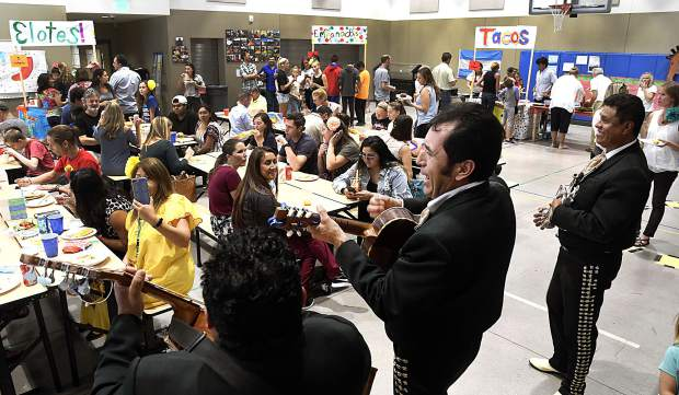 Students and their families enjoy an evening of fun at Two Rivers Community School in Glenwood Springs, as the school celebrates Hispanic Heritage Night Thursday with a mariachi band, food, games, dancing and more cultural activities.