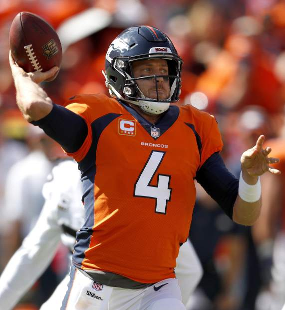Denver Broncos quarterback Case Keenum (4) looks to pass against the Oakland Raiders during the first half of an NFL football game, Sunday, Sept. 16, 2018, in Denver. (AP Photo/David Zalubowski)