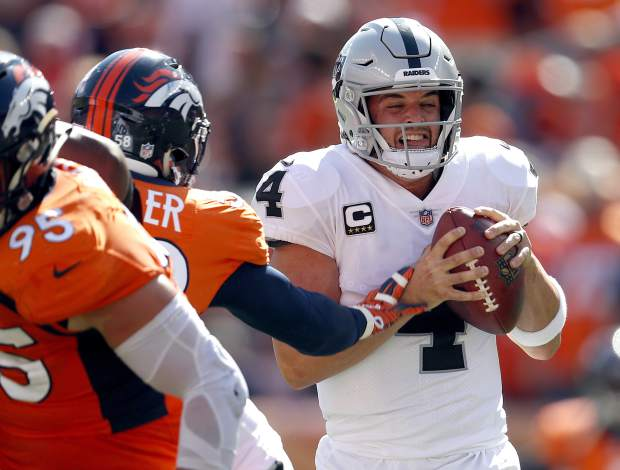 Oakland Raiders quarterback Derek Carr (4) is sacked by Denver Broncos linebacker Von Miller during the first half of an NFL football game, Sunday, Sept. 16, 2018, in Denver. (AP Photo/David Zalubowski)