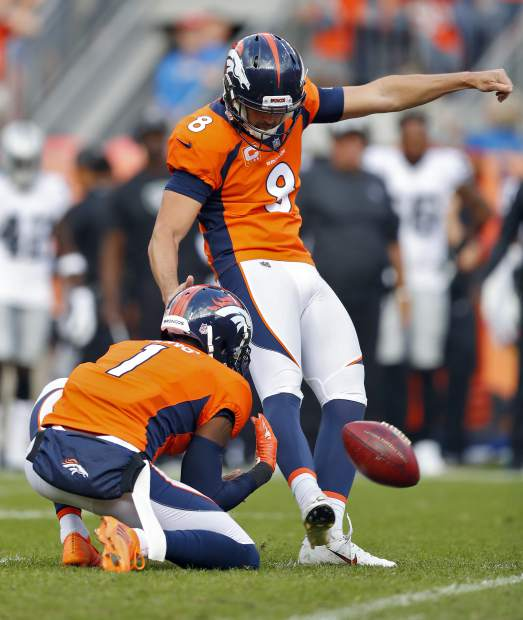 Denver Broncos kicker Brandon McManus (8) kicks the game winning field goal as punter Marquette King (1) holds during the second half of an NFL football game against the Oakland Raiders, Sunday, Sept. 16, 2018, in Denver. The Broncos won 20-19. (AP Photo/Jack Dempsey)