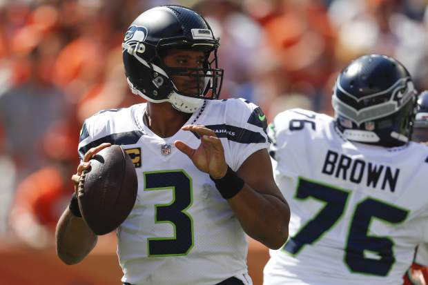 Seattle Seahawks quarterback Russell Wilson looks to throw a pass during the first half of an NFL football game against the Denver Broncos Sunday, Sept. 9, 2018, in Denver. (AP Photo/David Zalubowski)