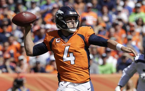 Denver Broncos quarterback Case Keenum throws a pass during the first half of an NFL football game against the Seattle Seahawks, Sunday, Sept. 9, 2018, in Denver. (AP Photo/Jack Dempsey)