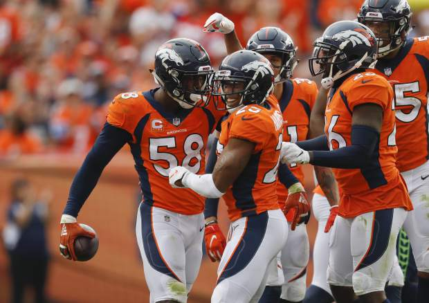 Denver Broncos linebacker Von Miller (58) reacts with teammates after grabbing a turnover during the second half of an NFL football game against the Seattle Seahawks Sunday, Sept. 9, 2018, in Denver. (AP Photo/David Zalubowski)