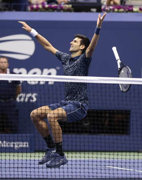 Novak Djokovic, of Serbia, celebrates after defeating Juan Martin del Potro, of Argentina, during the men's final of the U.S. Open tennis tournament, Sunday, Sept. 9, 2018, in New York. (AP Photo/Julie Jacobson)