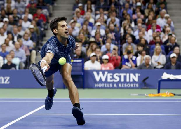 Novak Djokovic, of Serbia, returns a shot to Juan Martin del Potro, of Argentina, during the men's final of the U.S. Open tennis tournament, Sunday, Sept. 9, 2018, in New York. (AP Photo/Adam Hunger)