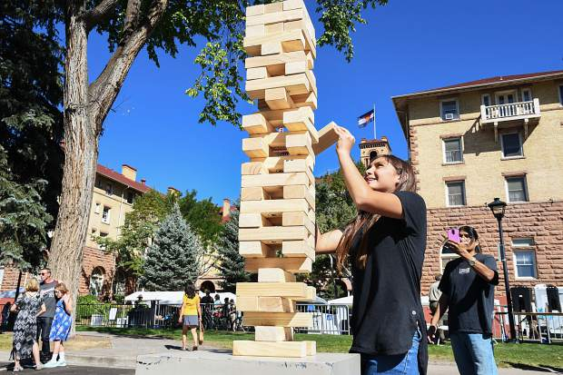 13-year-old Ana McCook tries to keep a steady hand while playing a game of giant jenga at the Hotel Colorado's Big Birthday Bash on Saturday morning.