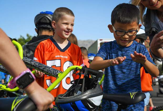 Sopris Elementary School second-graders Parker Gardey and Lincoln Robison celebrate their brand new bikes provided by Wish for Wheels at the school on Tuesday morning.