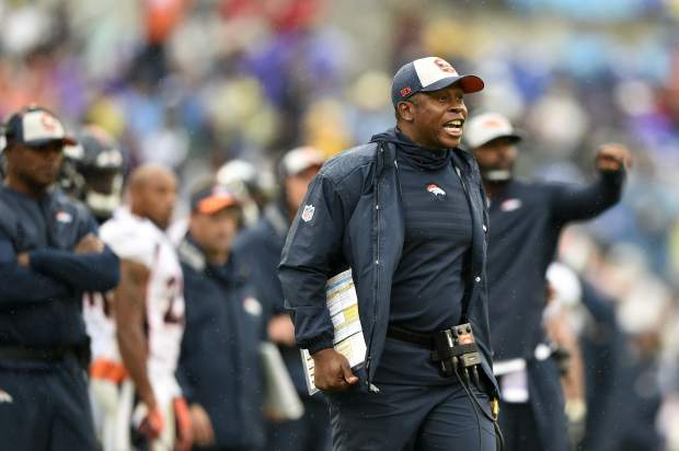 Denver Broncos head coach Vance Joseph yells from the sideline in the second half of an NFL football game against the Baltimore Ravens, Sunday, Sept. 23, 2018, in Baltimore. (AP Photo/Gail Burton)