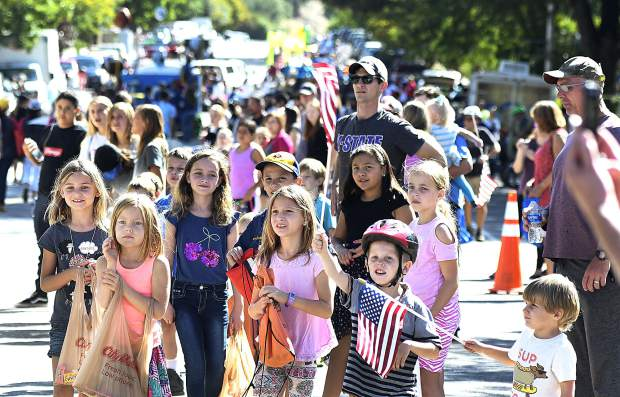 Eagerly awaiting candy, children line Main Street in downtown New Castle for the 46th annual Burning Mountain Festival parade in 2018.
