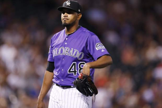 Colorado Rockies starting pitcher German Marquez reacts after striking out Arizona Diamondbacks' Steven Souza Jr. to end the top of the sixth inning of a baseball game Monday, Sept. 10, 2018, in Denver. (AP Photo/David Zalubowski)