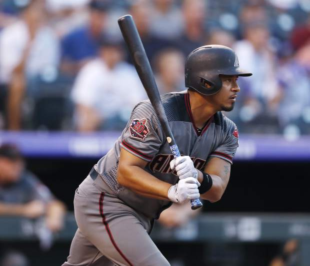Arizona Diamondbacks' Eduardo Escobar follows the flight of his RBI-single off Colorado Rockies starting pitcher German Marquez in the first inning of a baseball game against the Monday, Sept. 10, 2018, in Denver. (AP Photo/David Zalubowski)