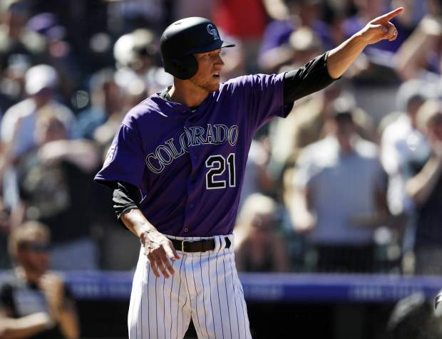 Colorado Rockies' Kyle Freeland gestures to David Dahl after his double drove in Freeland in the fourth inning of a baseball game against Arizona Diamondbacks, Thursday, Sept. 13, 2018, in Denver. (AP Photo/David Zalubowski)