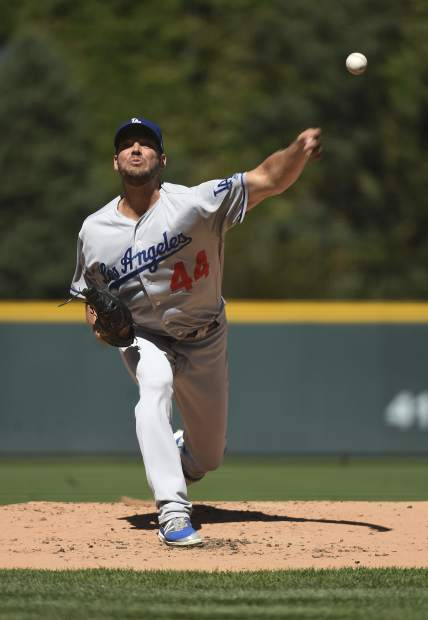 Los Angeles Dodgers starting pitcher Rich Hill (44) delivers against the Colorado Rockies in the first inning of a baseball game Sunday, Sept. 9, 2018, in Denver (AP Photo/John Leyba)