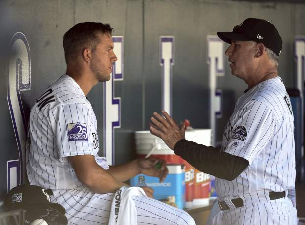 Colorado Rockies manager Bud Black, right, talks with starting pitcher Tyler Anderson, left, in the dugout after the second inning of a baseball game against the Los Angeles Dodgers, Sunday, Sept. 9, 2018, in Denver. (AP Photo/John Leyba)