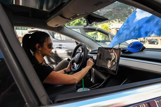 Maisa Metcalf, who works for CLEER, checks out the Tesla Model 3 at the electric vehicle ride and drive event that took place in downtown Glenwood on Tuesday afternoon. Garfield Clean Energy, CLEER and the city of GLenwood Springs hosted an electric vehicle ride and drive event and invited community members to learn about and/or drive electric vehicles from six different dealers in a relaxed and low pressure environment.