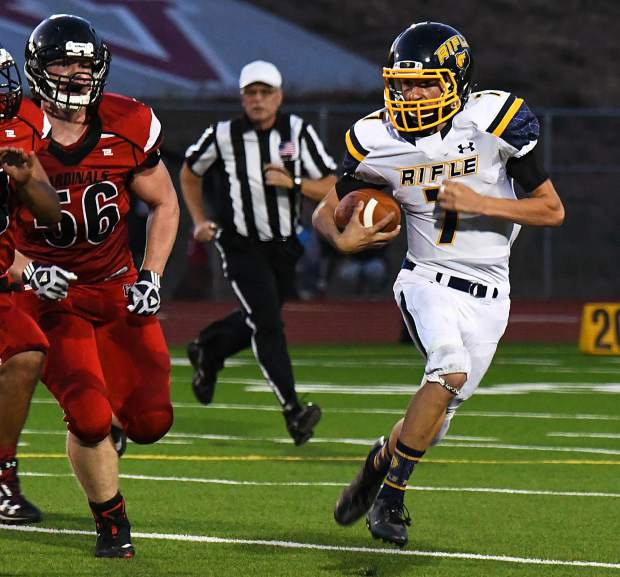Rifle Bear Holden Stutsman runs the ball past the defending Grand Valley Cardinals during Thursday night's game at Grand Valley High School.