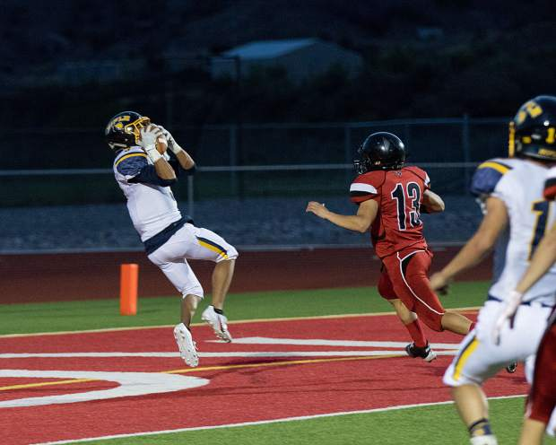 Kenny Tlaxcala hauls in a 26-yard touchdown pass from Holden Stutsman during Thursday's game in Rifle.