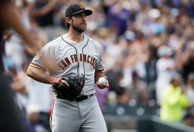 San Francisco Giants starting pitcher Madison Bumgarner reacts after giving up a two-run home run to Colorado Rockies' DJ LeMahieumin the first inning of a baseball game Monday, Sept. 3, 2018, in Denver. (AP Photo/David Zalubowski)