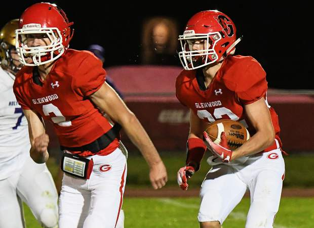 Glenwood Springs Demon Gavin Olson looks for an opening in the defending Holy Family Tigers during Friday night's game at Stubler Memorial Field.