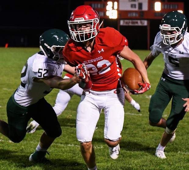 Glenwood Springs Demon Gavin Olson runs the ball down the field through the defending Conifer Lobos during Friday night's game at Stubler Memorial Field.