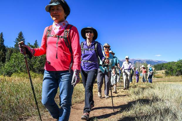 Sally Mehalek directs other members of the Wednesday Wanderers group during their hike to Hunter Creek in Aspen on Aug. 29.