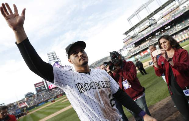 Colorado Rockies third baseman Nolan Arenado waves to fans after the ninth inning of a baseball game against the Washington Nationals Sunday, Sept. 30, 2018, in Denver. The Rockies won 12-0. (AP Photo/David Zalubowski)