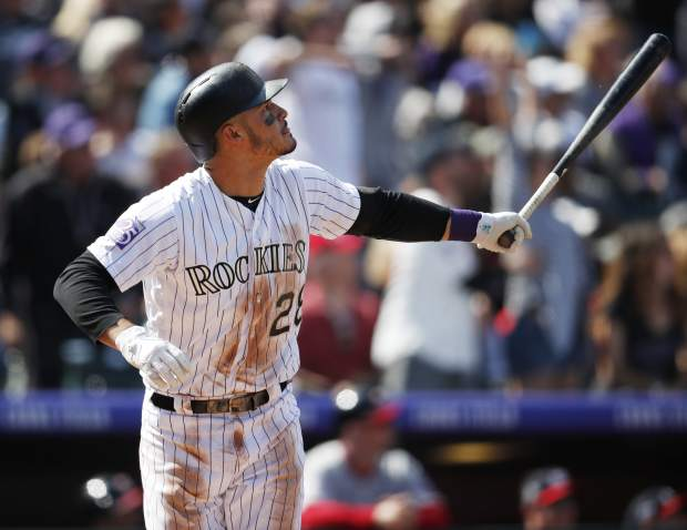 Colorado Rockies; Nolan Arenado follows the flight of his two-run home run off Washington Nationals relief pitcher Erick Fedde in the first inning of a baseball game Sunday, Sept. 30, 2018, in Denver. (AP Photo/David Zalubowski)