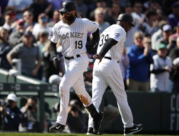 Colorado Rockies' Charlie Blackmon circles the bases after hitting a two-run home run off Washington Nationals starting pitcher Erick Fedde in the third inning of a baseball game Sunday, Sept. 30, 2018, in Denver. (AP Photo/David Zalubowski)