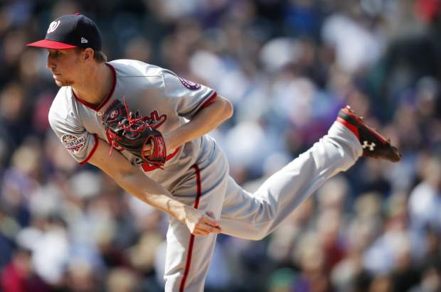 Washington Nationals relief pitcher Erick Fedde works against the Colorado Rockies in the first inning of a baseball game Sunday, Sept. 30, 2018, in Denver. (AP Photo/David Zalubowski)